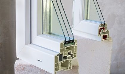 Two sample of PVC windows stands on concrete block
